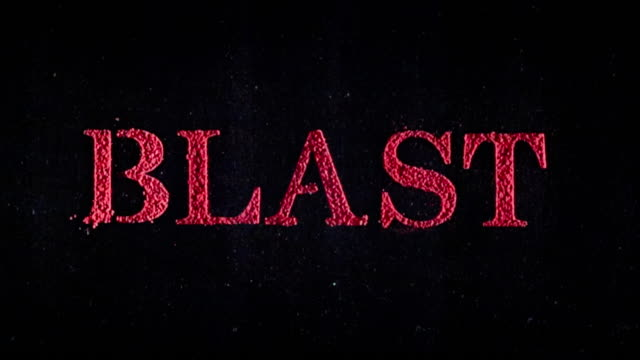 Blast written in red powder exploding in slow motion.
