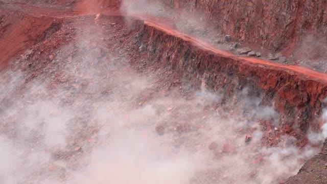 blasting operation in a qaurry - bergwerk stock-videos und b-roll-filmmaterial