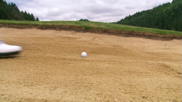 blasting out of the bunker - links golf stock videos & royalty-free footage