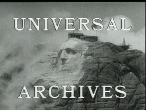 blasts of dynamite shape the sculpture of george washington's face on mount rushmore - ジョージ・ワシントン点の映像素材/bロール