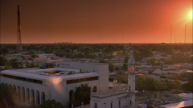 A blazing orange sun casts orange light over Merida, Yucatan, Mexico.