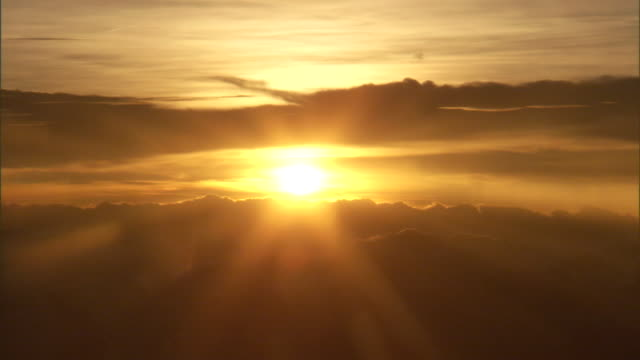 a blazing sun casts golden beams across the sky. - authority stock videos & royalty-free footage