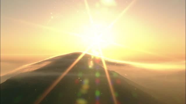 vidéos et rushes de a blazing sun shines above the kirishima mountain range in japan. - 1 minute et plus