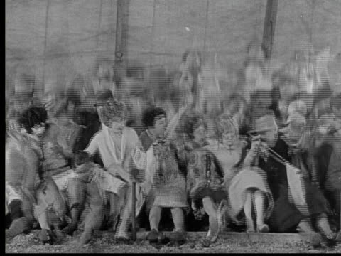1926 b/w ws bleachers collapsing as crowd falls on ground and then runs out of circus tent / usa - silent film stock videos & royalty-free footage