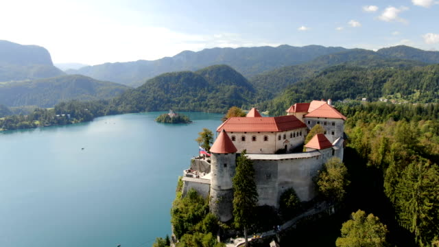 aerial bled castle and lake bled / slovenia - slowenien stock-videos und b-roll-filmmaterial