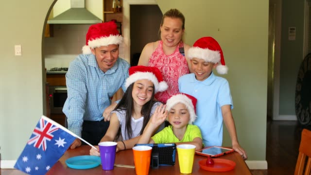 Blended Australian Family Face Timing At Christmas With Tablet Device