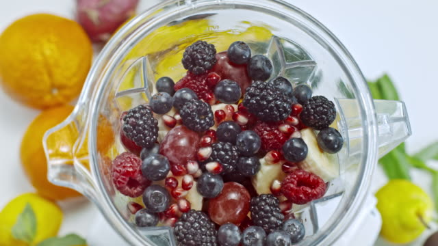 slo mo blender full of berries turning on the table - liquidiser stock videos and b-roll footage