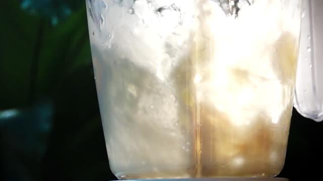 slow mo blender milkshake - strawberry milkshake stock videos & royalty-free footage