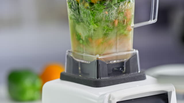 tu blender mixing mixed vegetable smoothie - mint leaf culinary stock videos and b-roll footage
