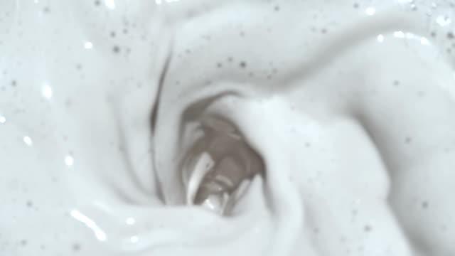blending milk at slow motion - milkshake stock videos & royalty-free footage