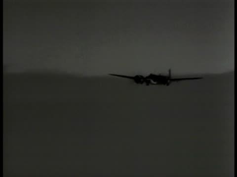 aerial blenheim iv bomber plane flying vs bomber airplanes flying through clouds german soldiers in open bunker hole large binoculars german soldiers... - binoculars stock videos & royalty-free footage