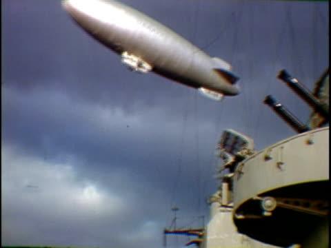 la ms blimp flying over uss missouri naval vessel new york city new york state usa - uss missouri stock videos and b-roll footage