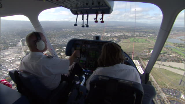 blimp pilots fly over a city. - switch stock videos & royalty-free footage