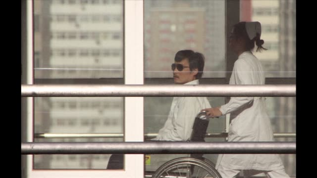 blind activist chen guangcheng on thursday accused authorities in his home province in eastern china of seeking revenge for his escape by detaining... - nephew stock videos and b-roll footage