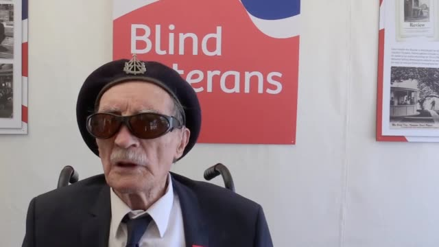 blind dday veteran alfred barlow receives replacement medals at the hampton court flower show after the originals were lost at a motorway service... - sostituzione video stock e b–roll