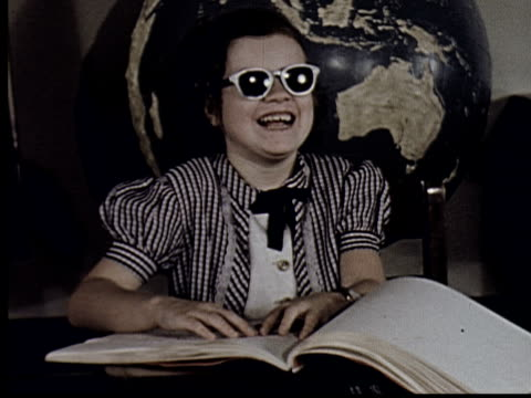 ms, composite, cu, blind girl (8-9) smiling while reading in braille at desk - visual impairment bildbanksvideor och videomaterial från bakom kulisserna