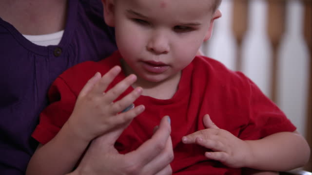 blind male toddler sitting in his mother's lap - all shirts stock videos & royalty-free footage