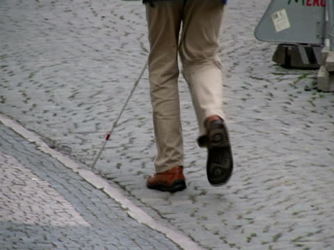 blind man uses cane - hand held - pavement stock videos & royalty-free footage