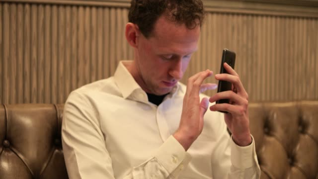 blind man using smartphone - blindness stock videos & royalty-free footage