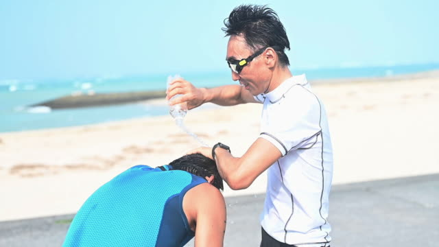 blind triathlete training on the beach - visual impairment stock videos & royalty-free footage