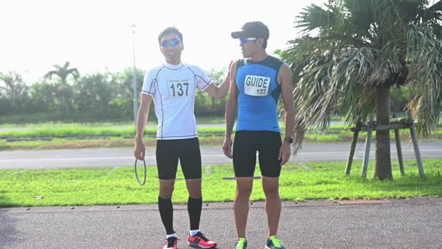 blind triathlete walking - persons with disabilities stock videos & royalty-free footage