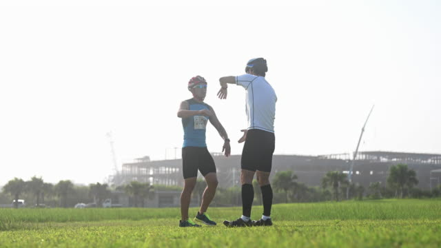 blind triathlete warm up exercise - visual impairment stock videos & royalty-free footage