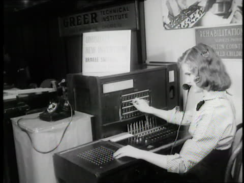 a blind woman operates a telephone switchboard with the help of a braille panel - assistive technology stock videos & royalty-free footage