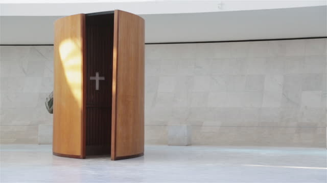 ms a blind woman walks past a confession box in brasilia cathedral / catedral metropolitana / brasilia, brazil - blind persons cane stock videos & royalty-free footage