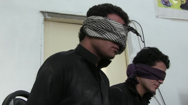 blindfolded detainees suspected to be isis or isil militants captured by fighters of the kurdish people's protection units ypg on october 13, 2014 in... - people's protection units stock videos & royalty-free footage