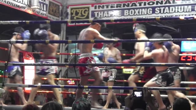 blindfolded fighters compete in muay thai boxing at thaphae boxing stadium in chiang mai - muay thai stock videos and b-roll footage