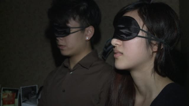 Blindfolded handcuffed and locked in a dark room under the gaze of a surveillance camera its not everybodys idea of fun CLEAN Hancuffed Hong Kongers...
