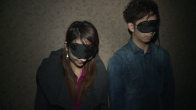 Blindfolded handcuffed and locked in a dark room under the gaze of a surveillance camera its not everybodys idea of fun VOICED Hancuffed Hong Kongers...