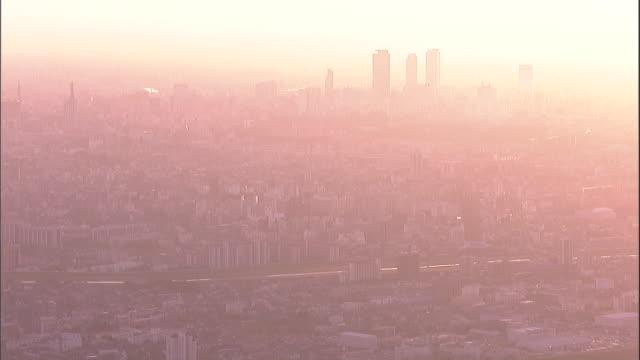 Blinding sunlight bleaches out the Nagoya city center.