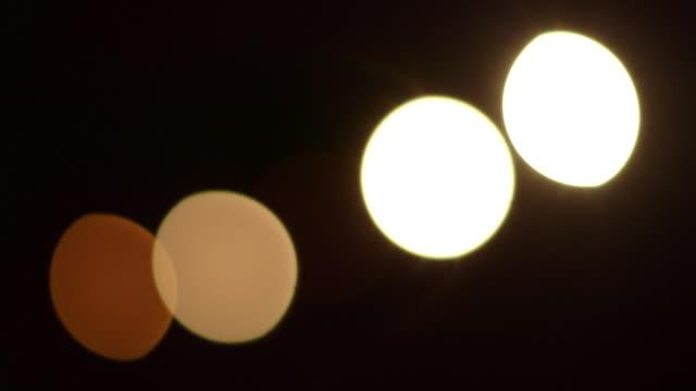 blinking bokeh in a diagonal line - five objects stock videos & royalty-free footage