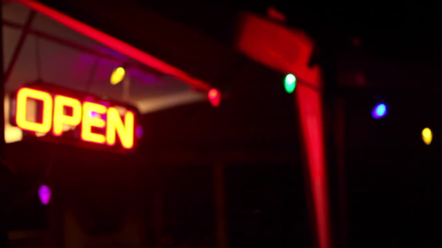 Blinking Neon Open Sign At Night + focus pull