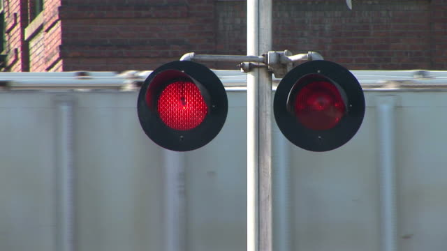 cu, blinking stop lights on railroad crossing, freight train in background, portland, oregon, usa - blinking stock videos & royalty-free footage