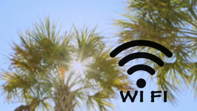 Blinzeln W-LAN-hotspot kabelloses Technologie mit Palmen