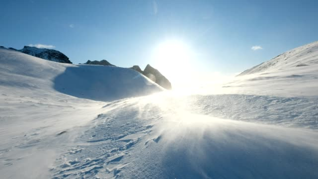 blizzard blowing on snowy mountain with sunshine - ice stock videos & royalty-free footage