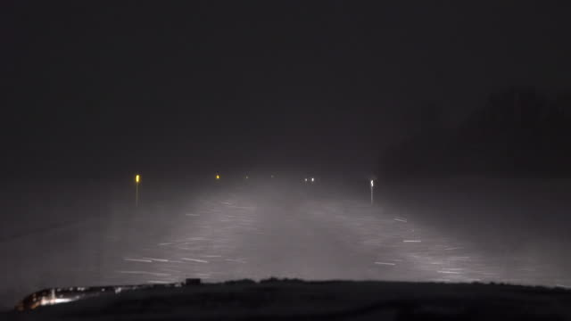blizzard conditions on a highway - scott mcpartland stock videos & royalty-free footage