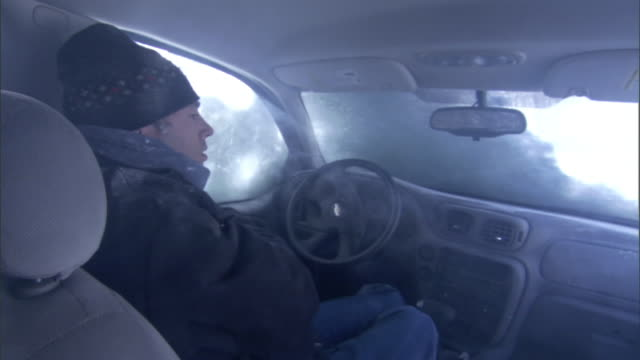 a blizzard traps a man in an suv. - trapped stock videos & royalty-free footage