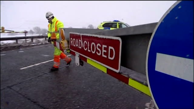 Blizzards and torrential rain sweep the country County Durham Road Closed sign on barrier being used to close the A66 because of snow and bad weather