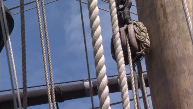 block and tackle on replica of hms endeavour sway with movement of the ship. - rigging stock videos & royalty-free footage