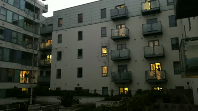 block of flats in london clapping and cheering for nhs during the clap for carers event during the coronavirus crisis - thank you englischer satz stock-videos und b-roll-filmmaterial