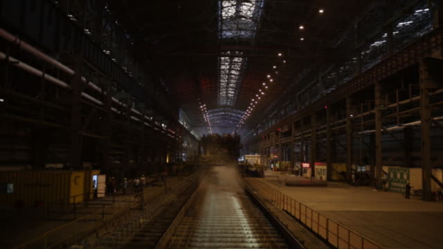 block of steel moving on conveyor belt at steel authority of india limited factory, rourkela, odisha, india, on friday, june 21, 2019. - 鉄点の映像素材/bロール