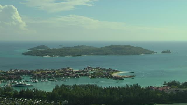 block shot aerial mahe victoria mahe seychelles - seychelles stock videos & royalty-free footage