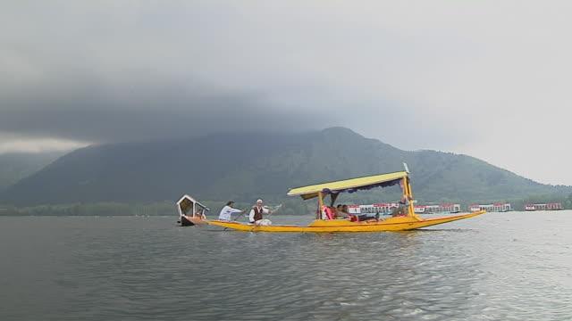 Block Shot Boat Passing Dal Lake Srinagar Jammu and Kashmir India