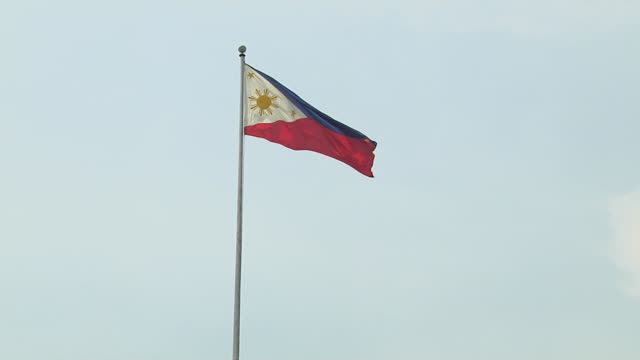 block shot flag post boracay philippines - philippines flag stock videos & royalty-free footage