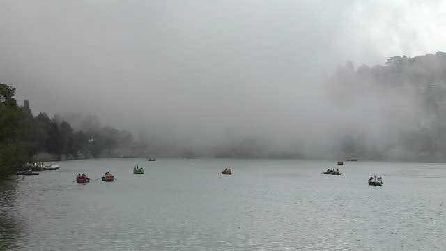 block shot foggy bhimtal lake nainital uttarakhand india - lake stock videos & royalty-free footage