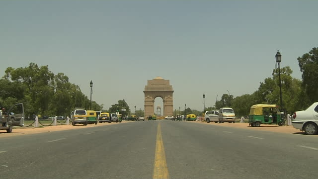 block shot india gate new delhi india - rickshaw stock videos and b-roll footage