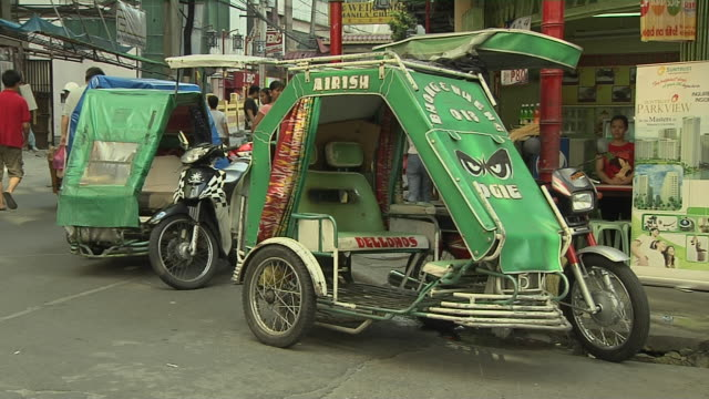 block shot tricycle  manila metro manila philippines - tricycle stock videos & royalty-free footage